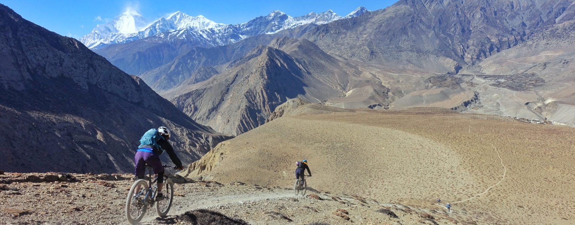 Mountain bike though the highest mountains in the world in Nepal